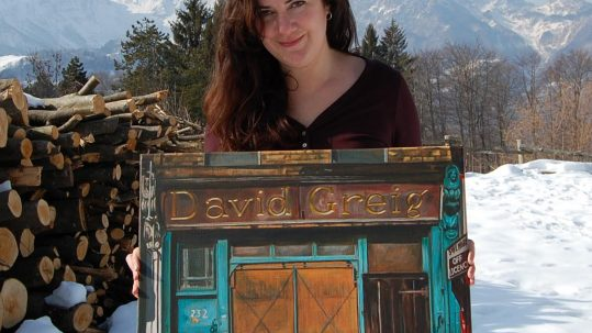 Michelle Heron with one of her paintings